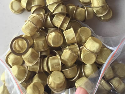 Several bowl shaped filters are made from brass woven mesh and brass edge.