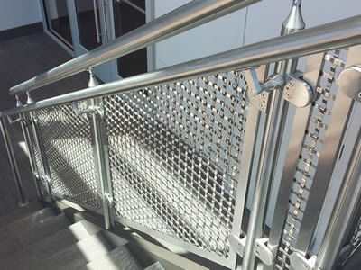 Stainless steel crimped wire mesh sheets are installed on stairs side.