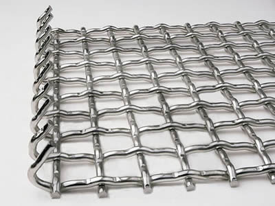 There is a stainless steel crimped wire mesh sheet with bent edge.