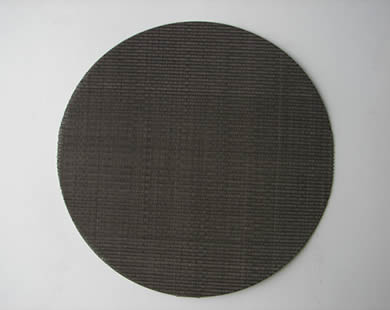 A round dutch weave black wire cloth filter disc.