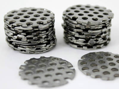 Several perforated filter discs with no margin stack together.