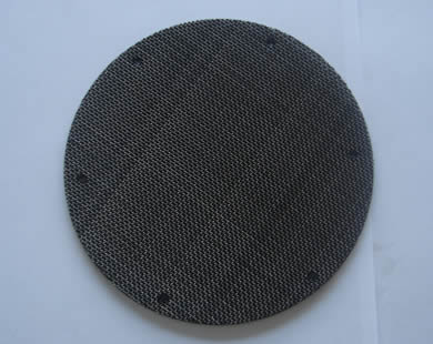 A round black wire cloth filter disc with spot welding.