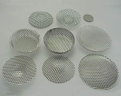Nine woven filter discs are placed together.